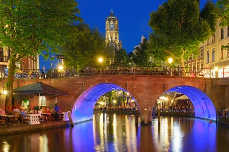 Photo pour Dom Tower and canal in the night colorful illuminations in the blue hour, Utrecht, Netherlands - image libre de droit