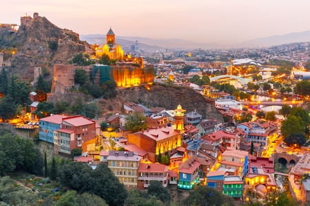 Photo pour Narikala, Jumah Mosque, Sulphur Baths and famous colorful balconies in old historic district Abanotubani in night Illumination at sunset, Tbilisi, Georgia. - image libre de droit