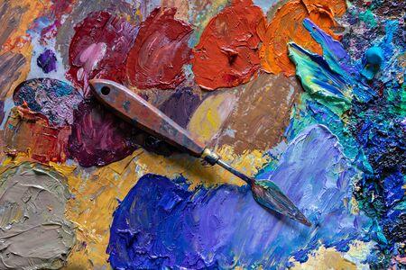 Foto de different color dried oil paint. colorful acrylic paint. modern art concept. painter palette knife. - Imagen libre de derechos