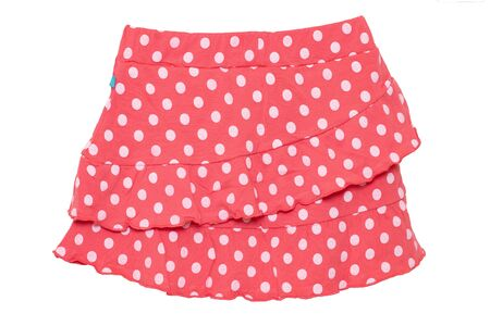 Photo pour Summer skirt isolated. Closeup of a beautiful red little girl short polka dot skirt isolated on a white background. Children and kids fashion. Macro. - image libre de droit