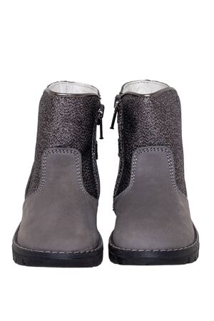 Photo pour Winter boots. Close-up of a pair elegant gray silver leather winter boots lined with white leather. Girls winter shoe fashion new trends isolated on a white background. Macro photograph. - image libre de droit