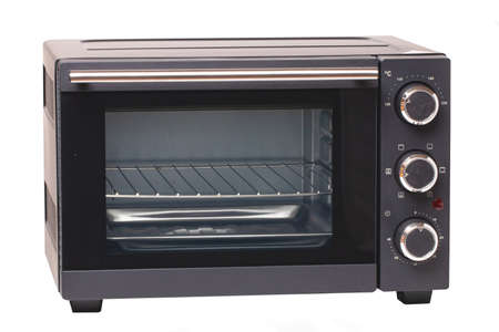 Photo for Kitchen electrical appliances. Close-up of a small electric oven isolated on a white background. Macro. - Royalty Free Image