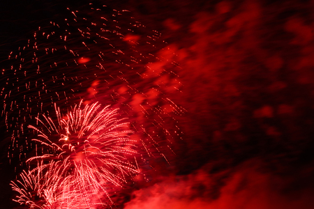Photo for Red fireworks in sky at the city - Royalty Free Image