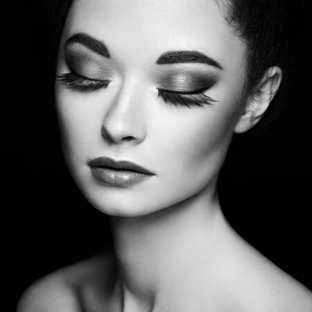 Photo pour Beautiful woman face. Perfect makeup. Beauty fashion. Eyelashes. Cosmetic Eyeshadow. Black and white photo. - image libre de droit