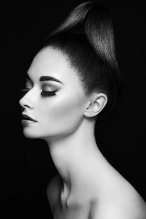 Photo for Beautiful woman face. Perfect makeup. Beauty fashion. Eyelashes. Cosmetic Eyeshadow. Elegant hairstyle. Black and white photo. - Royalty Free Image
