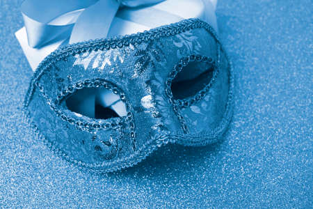 Photo pour Close up carnival mask on sparkle background. Trend color 2020 blue. Mardi gras or festive concept. - image libre de droit