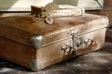 Beloved  grunge trash-suitcase and shabby book