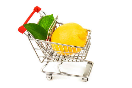 Foto für Lemon with green leaves in metal trolley isolated on white background - Lizenzfreies Bild