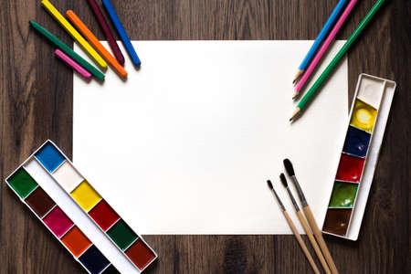 Photo pour brushes, paints, pencils on a white background. - image libre de droit