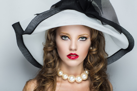 Closeup portrait of beautiful girl woman lady with professional make up and hair styling. Luxury accessory New Bright color makeup, shiny lipstick glossy cosmetics. Young pretty model vip person