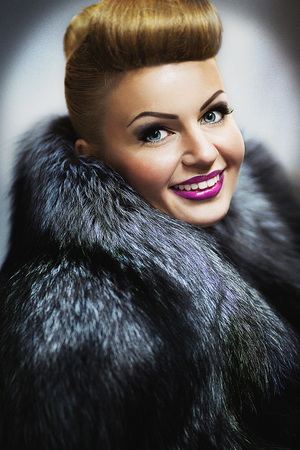 New Close up portrait of beautiful woman pretty lady sexy girl young face vip makeup. Long fur coat vest gray black coloring, surround collar warm in winter from cold. Clothing store, custom tailoring
