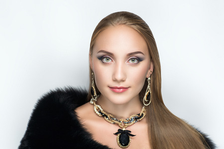 Closeup portrait of beautiful girl woman lady with professional make up and hair styling. Luxury accessory New Bright color makeup, shiny lipstick glossy cosmetics. Young pretty photo model vip person