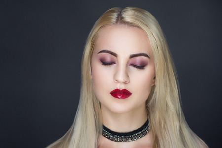 Closeup portrait of beautiful girl woman lady with volume combed hair styling. Luxury blonde gray white silver combed hair. Bright pink art makeup, shiny lipstick. Professional photo model vip person