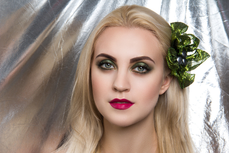 Closeup portrait beautiful girl woman lady with volume combed hair styling. Luxury blonde golden combed hair. New bright makeup, shiny lipstick cosmetics shadows. Professional photo model vip person