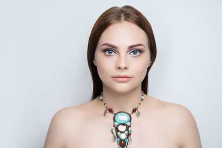 Young lady woman girl, bright make up, multicoloured shadows, beige lips lipstick lip gloss. Colorful silver glitters. massive wow necklace made of beads, colourful conceptual idea. Horizontal banner