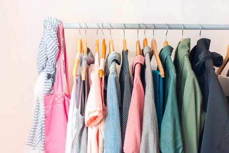 Pastel Color Female Clothes in a Row on Clothes Rail
