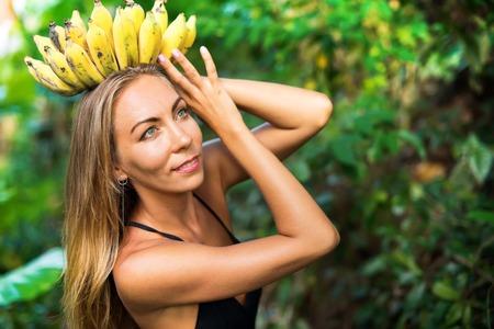 banana goddess young beautiful woman in tropical jungle caucasian suntan girl with bunch fruits as crown concept nature abundance