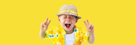 Photo for Child in yellow hawaiian shirt and straw hat shouts loud of the beginning of holidays, vacation, fun. Isolated yellow. Concept of summer - Royalty Free Image