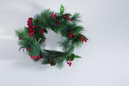 Foto de Holiday green Christmas decoration wreath on gray vintage wall. Happy New Year greeting card. Winter xmas theme - Imagen libre de derechos