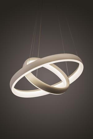 Photo pour Modern led pendant light lamp illuminated, fashionable designer chandelier in the form of rings. - image libre de droit