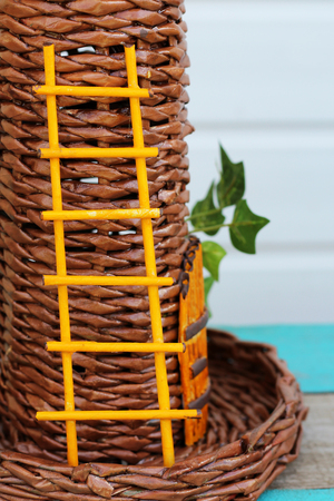 Yellow staircase handmade on a wicker tower, nature
