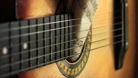Photo pour Guitar strings and torn paper notes, music idea - image libre de droit