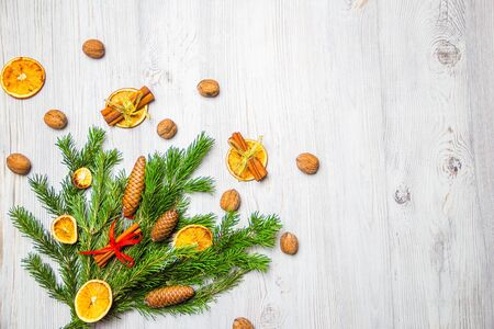 Photo pour Christmas and New Year composition. Pine branches, cinnamon sticks, dried slices of orange and walnuts. Christmas and New Year concept. Flat lay. - image libre de droit