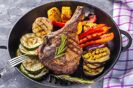Photo for Juicy steak and grilled vegetables in a pan. Life style. - Royalty Free Image