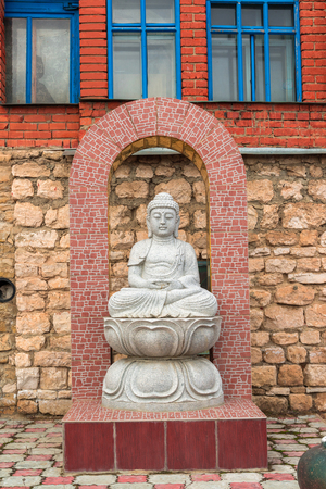 A Buddha statue in temple of all religions. The village of Old Arakchino. Kazan, Tatarstan.