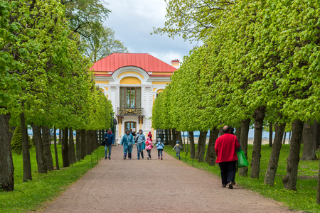 Peterhof, Russia - June 03. 2017. tourists around Pavilion Hermitage and Foliage Alley Lower Park