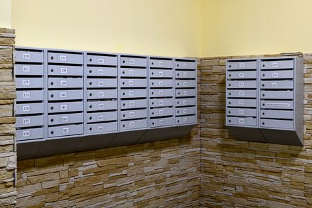 gray mailboxes in the corridor of the apartment building ...