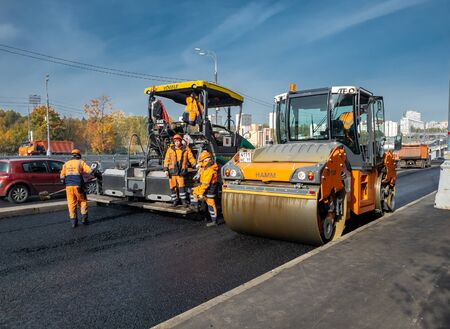 Photo for Moscow, Russia -October 9. 2018. Asphalt pavement repair using asphalt paver - Royalty Free Image