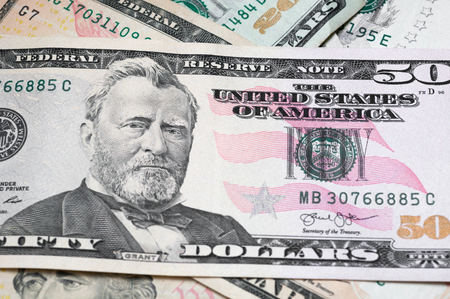 Close up of different dollar bills. Concept of money and earnings. Money savings.