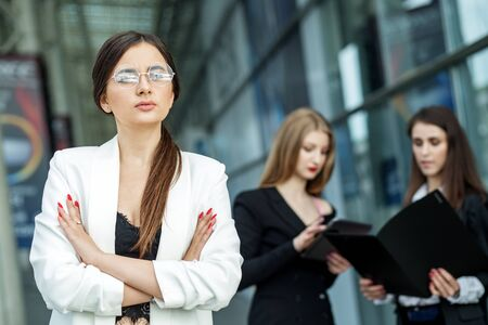 Foto de The woman head of the company is wearing glasses. Concept for business, marketing, finance, work, planning and lifestyle. - Imagen libre de derechos