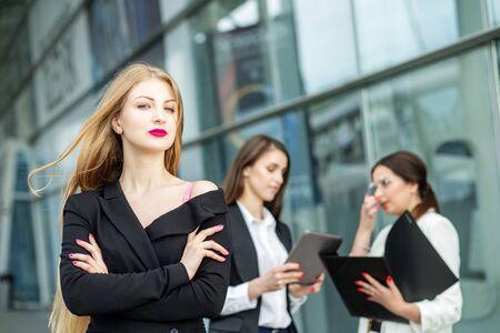 Photo pour A young woman with very long hair. Successful entrepreneur. Concept for business, boss, work, team and success. - image libre de droit