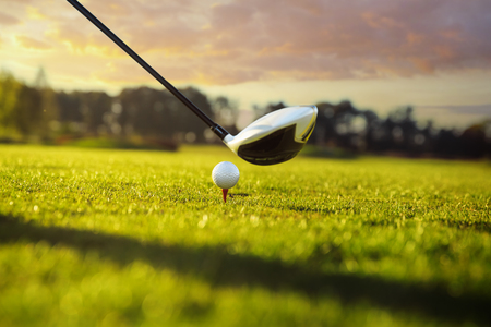 Photo for Golf ball on tee in front of driver - Royalty Free Image