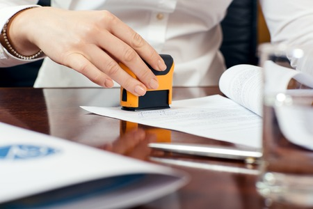Photo pour female hand stamping document, working at office - image libre de droit