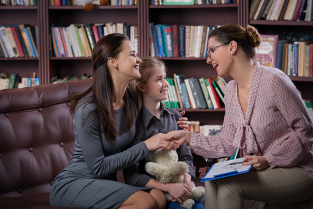 Photo for Young mom with her daugher at psychologist consultation - Royalty Free Image
