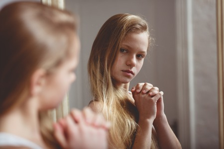 Reflection in mirror of teenage girl
