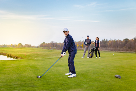 Foto de Happy family is playing golf in autumn - Imagen libre de derechos