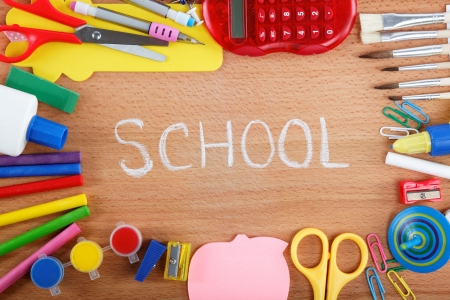 office and student accessories on wooden background  Back to school concept