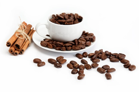 cup with coffee beans isolated on white background