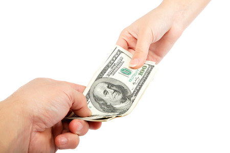 Transferring of money from hand to hand is isolated on a white background.