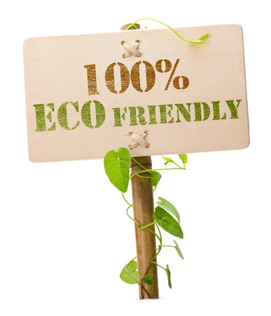 eco friendly sign message on a wooden panel and green plant - image is isolated on a white background