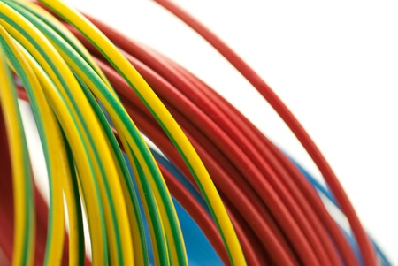 3 colors copper cables red, blue, and green yellow isolated over white background