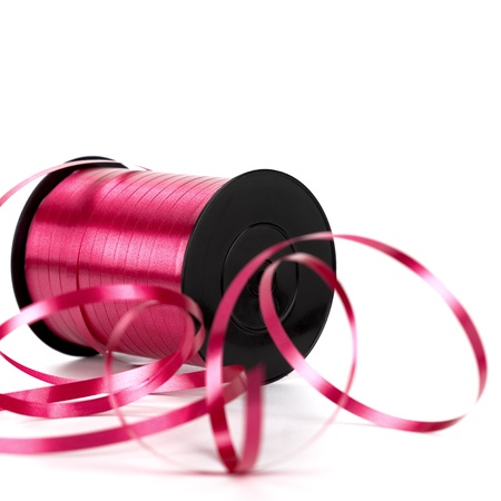 bobbin of pink ribbon for gift. Image over white background