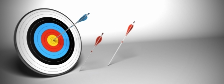 Target and arrow over a gray background horizontal banner. the blue arrow hit the center of the target and the red ones failed to reach their goal