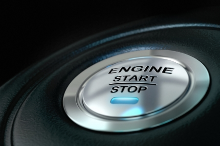 Car engine start and stop button with blue light anf black textured background, close up and details on the text