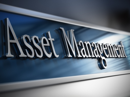 Asset management plaque in front of a building with depth of field effect and blue tones