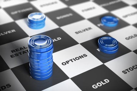 Blue checkers pieces over a financial board where it is written some investment words  Financial concept
